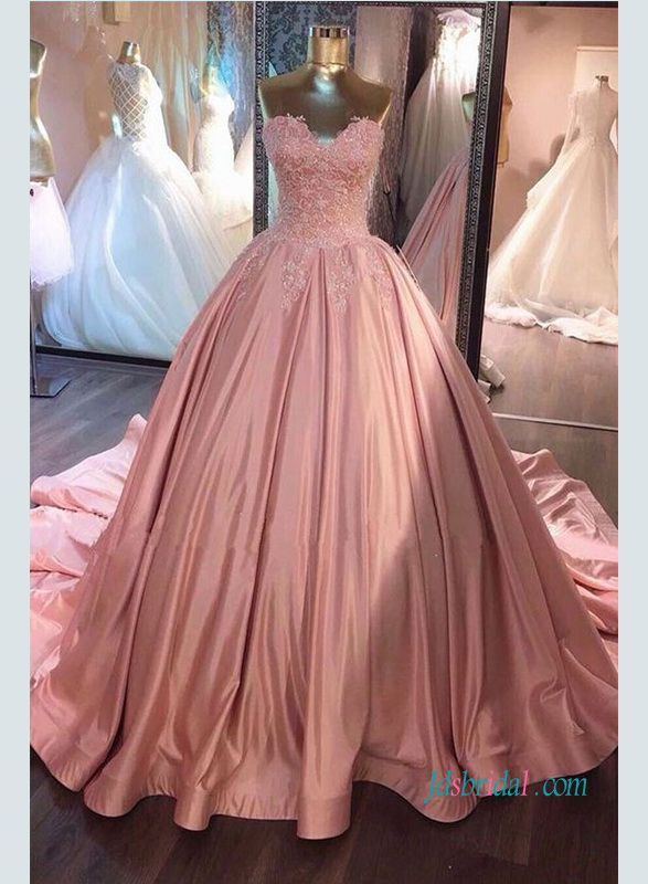 strapless deep pink colored satin ball gown wedding dress with lace appliqued sweetheart bodice