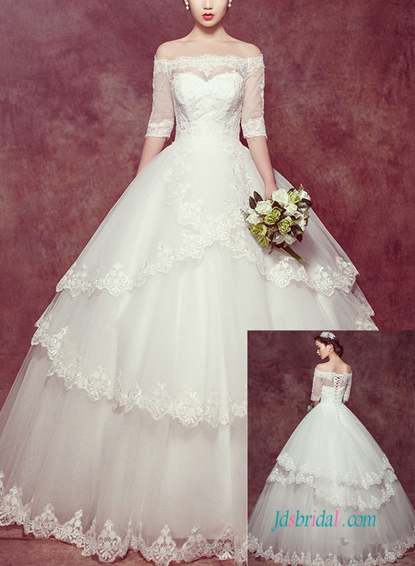 beautiful off shoulder tiered tulle ball gown wedding dress with half length sleeves