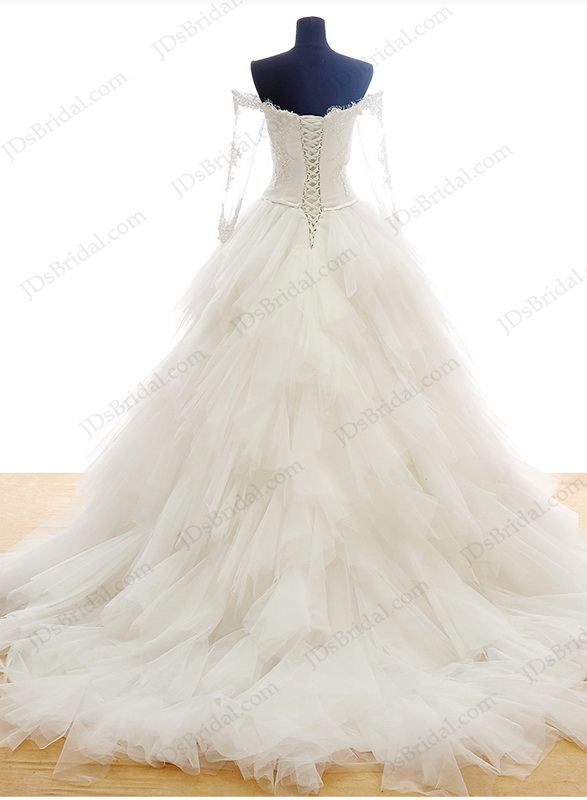 dreamy princess sweetheart neckline ball gown wedding dress with long sleeves and puffy ruffled skirt
