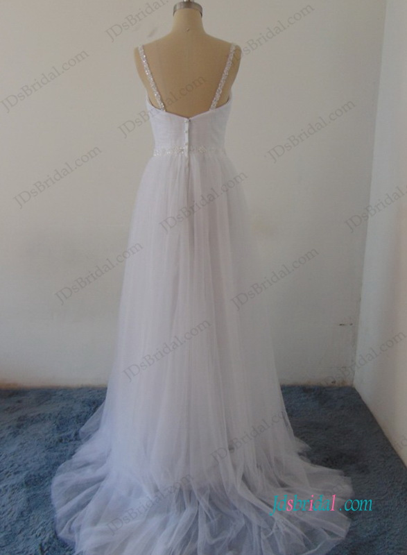 soft and airy tulle beach wedding dress with flowy a line skirt and low back