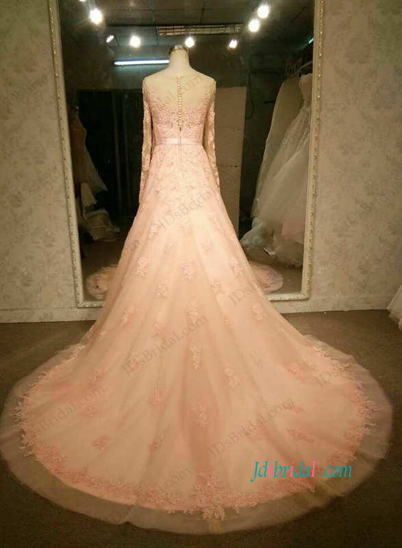 feminine blush pink colored a line lace wedding dress with long sleeves and illusion lace back