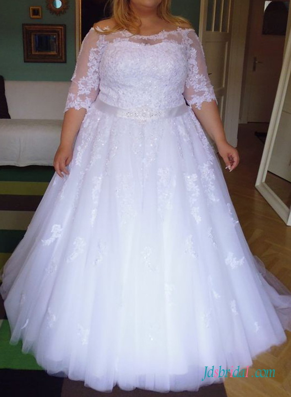 white plus size wedding dress with off the shoulder neckline and 1/2 length sleeves tulle bridal gown